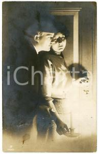 1912 COUPLE Romantic lovers with candle - Vintage postcard