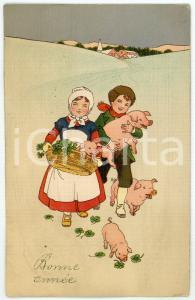 1914 BONNE ANNÉE Children walking in the snow with lucky pigs - Postcard