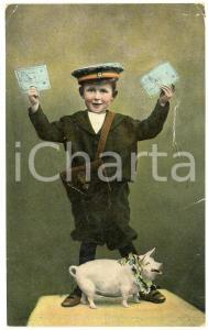 1908 Child conductor holding tickets with a pig - Old postcard