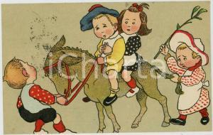 1905 ca CHILDREN playing with a donkey ILLUSTRATED Postcard FP VG